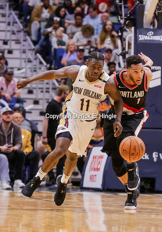 Mar 27, 2018; New Orleans, LA, USA; New Orleans Pelicans guard Jrue Holiday (11) battles Portland Trail Blazers forward Evan Turner (1) for a loose ball during the second quarter at the Smoothie King Center. Mandatory Credit: Derick E. Hingle-USA TODAY Sports
