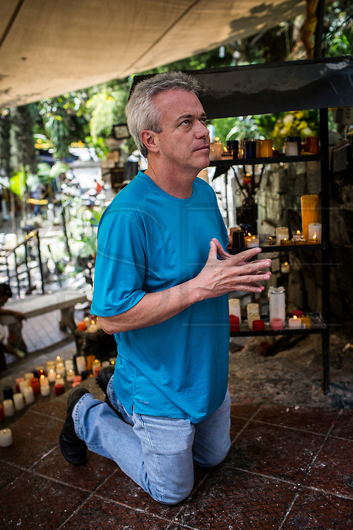 "2015/11/24 - Medellín, Colombia: John Velásquez, best known as ""Popeye"", prays to Maria ""Rosa Mistica"", the Virgin of Aguacatala in Medellín. ""Popeye"" was Pablo Escobar's former head assassin who was released last year from jail after 23 years of imprisonment. He confesses being the author of about 300 hundred murders ordered by Colombia's most famous drug lord. Velásquez is trying to integrate in society, writing already two book about his time with Escobar and has plans to make a movie. (Eduardo Leal)"