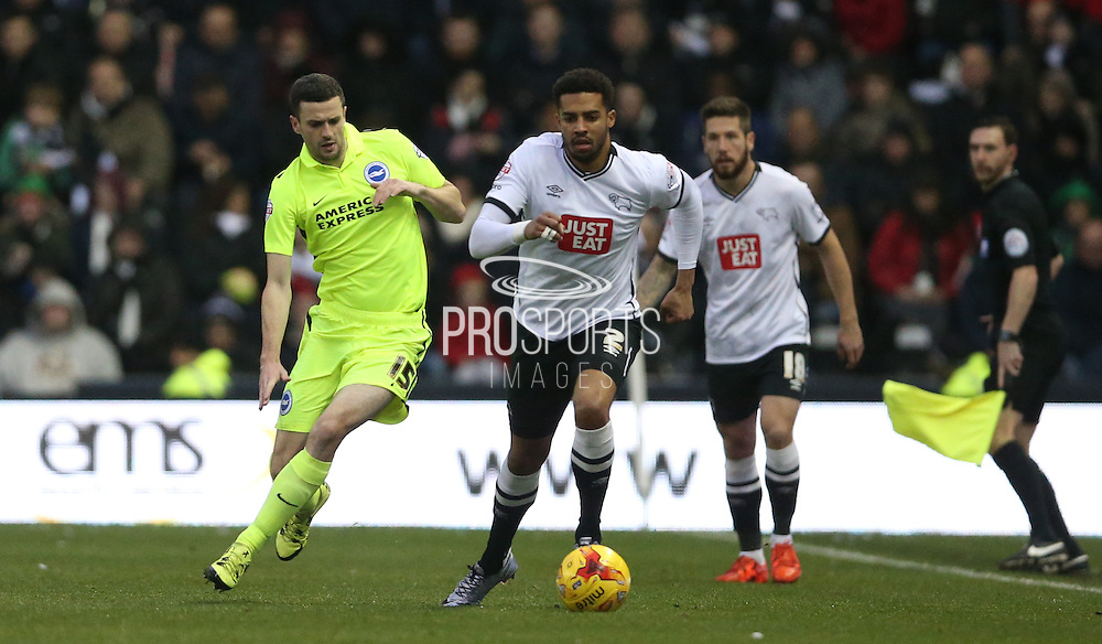 Derby County defender Cyrus Christie gets away from Brighton winger, Jamie Murphy (15) during the Sky Bet Championship match between Derby County and Brighton and Hove Albion at the iPro Stadium, Derby, England on 12 December 2015.