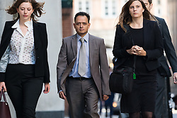 © Licensed to London News Pictures. 24/09/2018. London, UK.  MANISH SHAH (centre), a family doctor from Romford arrives at the Old Bailey in London this morning. Manish Shah, 48 is accused of 32 sexual assaults and 44 counts of assault by penetration against 19 women during unnecessary examinations. Photo credit: Vickie Flores/LNP