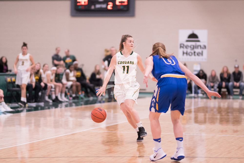4th year guard Britton Belyk (11) of the Regina Cougars during the Women's Basketball home game on November 24 at Centre for Kinesiology, Health and Sport. Credit: Arthur Ward/Arthur Images