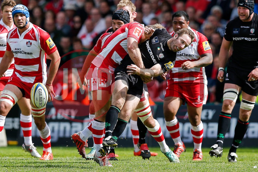 London Irish Scrum-Half Tomás O'Leary is tackled by Gloucester Flanker Matt Kvesic who receives a controversial red card for a dangerous tip tackle - Photo mandatory by-line: Rogan Thomson/JMP - 07966 386802 - 09/05/2015 - SPORT - RUGBY UNION - Gloucester, England - Kingsholm Stadium - Gloucester Rugby v London Irish - Aviva Premiership.