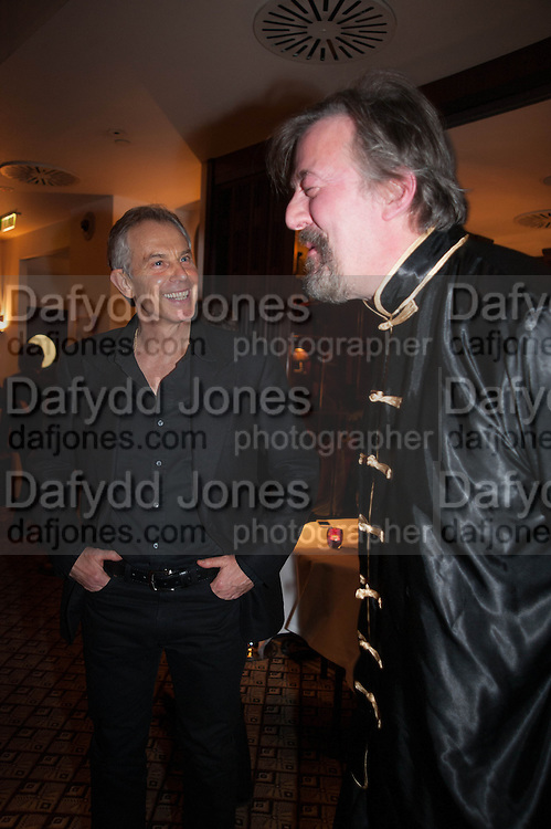 TONY BLAIR; STEPHEN FRY, Chinese New Year dinner given by Sir David Tang. China Tang. Park Lane. London. 4 February 2013.