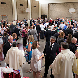 4 JUNE 2016 -- ST. LOUIS -- Families, friends and clergy gather in Boland Hall for a reception following the Ordination of Deacons at the Cathedral Basilica of St. Louis Saturday, June 4, 2016 in St. Louis. Eighteen men from across the Archdiocese were ordained.<br /> <br /> Photo by Sid Hastings.