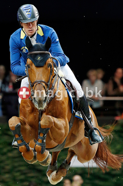 Christian Ahlmann of Germany rides his horse Epleaser van T Heike during the Mercedes-Benz Classic - Longines FEI World Cup jumping at the Equestrian Mercedes CSI held at the Hallenstadion in Zurich, Switzerland, Sunday, January 31, 2016. (Photo by Patrick B. Kraemer / MAGICPBK)