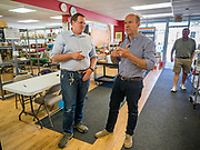 23 MAY 2019 - DES MOINES, IOWA: Congressman JOHN DELANEY (D-MD), right, and RYAN MARQUARDT, General Manager of the Iowa Food Cooperative in Des Moines. He toured the co-op to help understand how Iowa farmers are finding new markets. Delaney is running to be the Democratic nominee for the US Presidency in the 2020 election and has visited all 99 of Iowa's counties. Iowa traditionally hosts the the first election event of the presidential election cycle. The Iowa Caucuses will be on Feb. 3, 2020.                         PHOTO BY JACK KURTZ