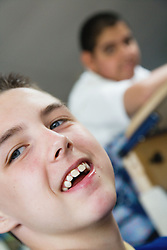 Child with learning difficulties in lesson,