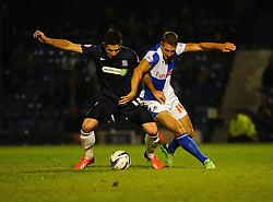 Southend United's Ryan Leonard battles with Bristol Rovers' Lee Brown - Photo mandatory by-line: Seb Daly/JMP - Tel: Mobile: 07966 386802 27/09/2013 - SPORT - FOOTBALL - Roots Hall - Southend - Southend United V Bristol Rovers - Sky Bet League Two