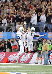 Texas A&M Aggies running back Ben Malena (1) and quarterback Johnny Manziel (2) celebrate a touchdown during the 77th AT&T Cotton Bowl Classic between the Texas A&M University Aggies and the Oklahoma University Sooners at Cowboys Stadium in Arlington, Texas. Texas A&M wins the 77th AT&T Cotton Bowl Classic against Oklahoma, 41-13.