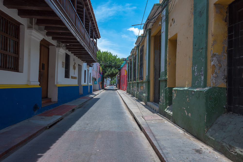 A quiet side street leading to a park in Santa Marta