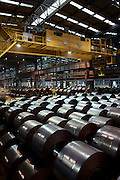 Coils of steel freshly made and cooling down at the Hyundai Steel plant. Dangjin, Korea. 2012