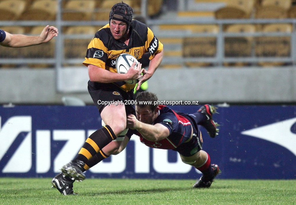 Tony Penn of Taranaki gets tackled by Chris Jack of Tasman during the Air NZ Cup rugby match between Taranaki and Tasman at Yarrow Stadium, New Plymouth, New Zealand on Saturday 30 September, 2006. Photo: Marty Melville/PHOTOSPORT