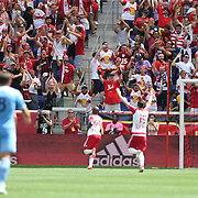 HARRISON, NEW JERSEY- JULY 24: New York Red Bulls fans celebrate as Bradley Wright-Phillips #99 of New York Red Bulls celebrates his second goal in his sides 4-1 win  during the New York Red Bulls Vs New York City FC MLS regular season match at Red Bull Arena, Harrison, New Jersey on July 24, 2016 in Harrison, New Jersey. (Photo by Tim Clayton/Corbis via Getty Images)