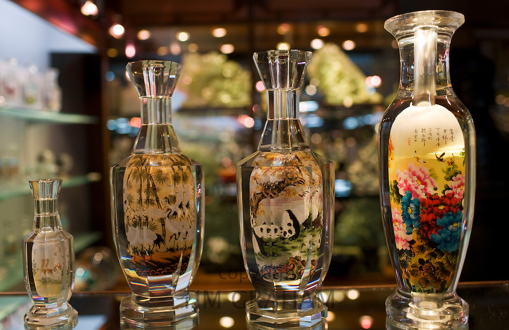 Glass bottles hand-painted on the inside displayed in Beijing Dragon Land jade gallery in Beijing, China