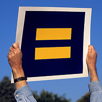 Man holding an equality sign.