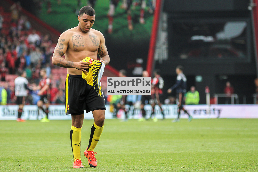 Troy Deeney takes off his shirt to give to a fan after Bournemouth vs Watford on Saturday 3rd of October 2015.