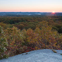 Sunrise from Sunset Rock looking out at the forest on Thompson Street, Gloucester, Massachusetts..