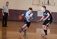 Gilford's Hunter Wilson and Sanbornton's Riley Mann charge down court during the Senior Boys division game of the 21st annual Francoeur Babcock Basketball Tournament  Friday evening.  (Karen Bobotas/for the Laconia Daily Sun)
