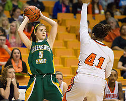 Greenbrier East forward Katelyn Wilmer (5) passes the ball over South Charleston center Aryaunne Mosley (41) during a first round game at the Charleston Civic Center.
