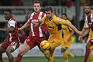 Mitch Brundle of Cheltenham Town puts pressure on Andy Sandell of Newport County. Skybet football league 2 match, Newport county v Cheltenham Town at Rodney Parade in Newport, South Wales on Saturday 22nd Feb 2014.<br /> pic by Mark Hawkins, Andrew Orchard sports photography.