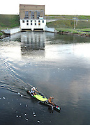 Brad Wilson of Cerdar Springs, MI and Flash Marsh of Mio, MI paddle away from the Alcona Dam after portaging.
