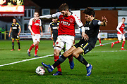 Fleetwood Town forward Ched Evans (9) on loan from Sheffield United,  is tackled by Wimbledon defender Will Nightingale (5)  during the The FA Cup 3rd round match between Fleetwood Town and AFC Wimbledon at the Highbury Stadium, Fleetwood, England on 5 January 2019.