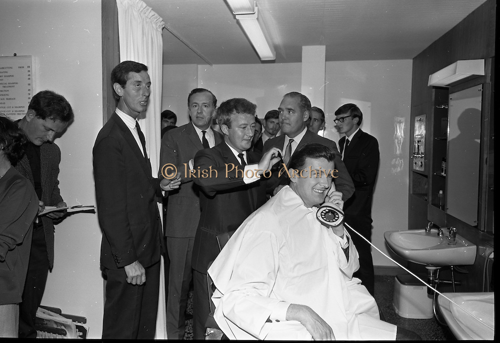 17/07/1967<br /> 07/17/1967<br /> 17 July 1967<br /> Opening of new men's salon at Brown Thomas, Grafton Street, Dublin. Brendan O'Reilly, the TV personality opened a new Mens Department in Brown Thomas and Co. Ltd.. In the new department was a hairdressing salon where while getting your hair done it was possible to make phone calls from the chair. Image shows (l-r): Mr. Sydney Fisher, Joint General Manager, Richard Henry International Hairdressers; Mr. john McGuire, Managing Director, Brown Thomas Group; Mr. Tony Byrne who is in charge of the hairdressing salon; Senator E. Rooney and Brendan O'Reilly seated using one of the phones in the salon.