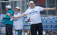 Buxton water volunteer. The Virgin Money London Marathon, 23rd April 2017.<br /> <br /> Photo: Ben Queenborough for Virgin Money London Marathon<br /> <br /> For further information: media@londonmarathonevents.co.uk