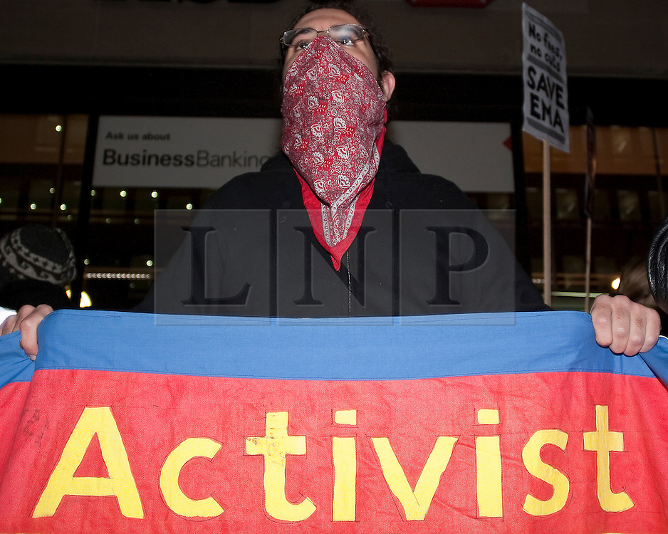 © under license to London News Pictures. 13/12/10. A Protesters demonstrate outside the Department of Trade and Industry in Westminster, London, over government plans plans to stop educational maintenance allowance (EMA). Credit should read Matt Cetti-Roberts/London News Pictures