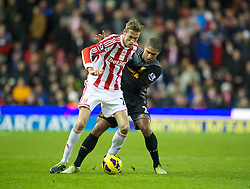 STOKE-ON-TRENT, ENGLAND - Boxing Day Wednesday, December 26, 2012: Liverpool's Glen Johnson in action against Stoke City's Peter Crouch during the Premiership match at the Britannia Stadium. (Pic by David Rawcliffe/Propaganda)
