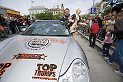 "Start of Gumball 3000 particpants from Vienna to Budapest, after a ""breakfast stop"" at Kursalon Hübner at the Stadtpark..The co-pilot of a Porsche 911 Turbo presenting his girlfriend to the crowd..Gumball 3000 is an ""illegal"" race on public streets for millionaires and show-buiz people in sports cars. Starting in London on April 30, 2006 and finishing 8 days later in Los Angeles...this one is just NUTS, 120 amazing cars driving 3000 miles across 3 Continents in just 8 days! More info at www.gumball3000.com"