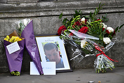 © Licensed to London News Pictures. 23/03/2017. London, UK. Floral tributes left for PC KEITH PALMER near the scene of the attack, the day after a lone terrorist killed 4 people and injured several more, in an attack using a car and a knife. The attacker managed to gain entry to the grounds of the Houses of Parliament, killing one police officer. Photo credit: Ben Cawthra/LNP
