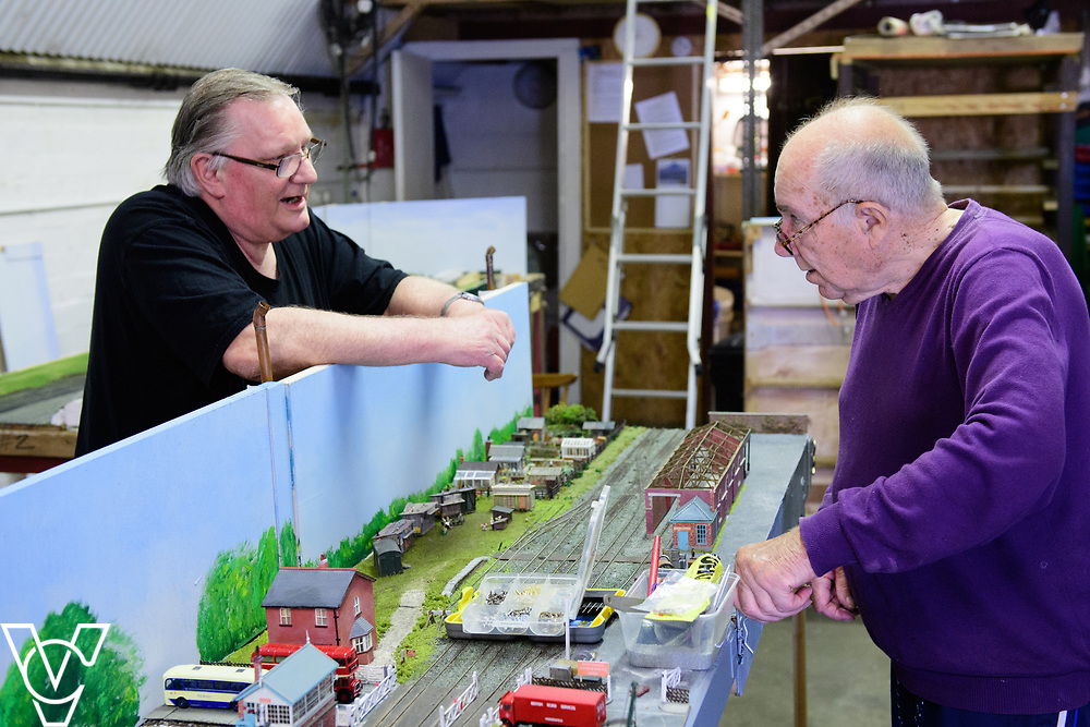 INSIGHT MAGAZINE: Bridlington Model Railway Society are based in Station Road, Bridlington, in a railway arch unit owned by Network Rail.  Pictured is Graham Wilson, left, and Trevor Pritchard working on the model of Filey Station.<br /> <br /> Picture: Chris Vaughan Photography<br /> Date: May 31, 2017