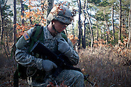 Apr, 10, 2011, Camp Edwards, Massachusetts - Cadet Jon Broderick uses his radio to communicate an order. Photo by ©Lathan Goumas.