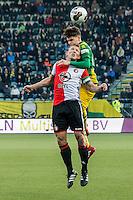 DEN HAAG - ADO Den Haag - Feyenoord , Voetbal , Eredivisie , Seizoen 2016/2017 , Kyocera Stadion , 19-02-2017 , ADO Den Haag speler Danny Bakker (achter) in kop duel met Feyenoord speler Dirk Kuyt (voor)