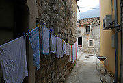 Washing on line against stone wall, village of Ston, Croatia