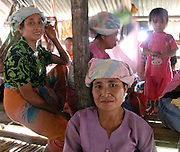 Alpha 1 Phase 1 Kampung Tampasak Kindegarten Building Project. Spring 2008, Malaysian Borneo. Sungai locals in the village longhouse prepare for a funeral..Young paticipants in the Raleigh International Spring 2008 expedition to Borneo help to build a new kindegarten in a the remote kampung (village) of Tampasak in Sabah, Malaysian Borneo.