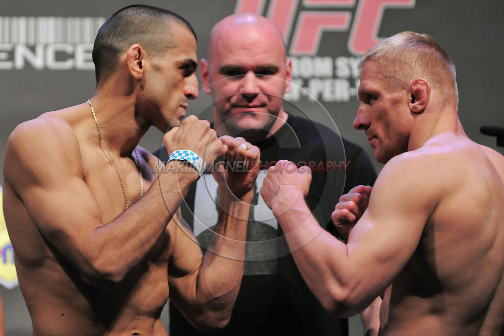 """SYDNEY, AUSTRALIA, FEBRUARY 26, 2011: George Sotiropoulos (left) faces off against opponent Dennis Siver during the weigh-in for """"UFC 127: Penn vs. Fitch"""" inside Acer Arena in Sydney, Australia on February 26, 2011"""