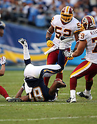 San Diego Chargers wide receiver Kassim Osgood (81) gets upended during the NFL football game against the Washington Redskins, January 3, 2010 in San Diego, California. The Chargers won the game 23-20. ©Paul Anthony Spinelli