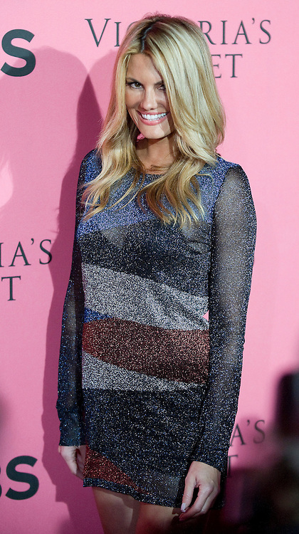 Spike TV host Courtney Hansen poses for photos on the Pink Carpet before the start of Tuesday's viewing party for the 2011 Victoria's Secret Fashion Show at the Samueli Theater at the Segerstrom Center  for the Arts in Costa Mesa.