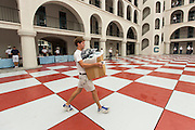 An incoming Citadel freshman known as a knob walks to his barracks careful to avoid the red squares during matriculation day on August 17, 2013 in Charleston, South Carolina. The Citadel is a state military college that began in 1843.