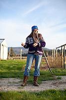 Portrait of woman at small farm along the Oregon coast.