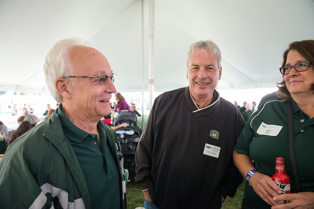 Dean of Ohio University's College of Business, Hugh Sherman, left, attends the homecoming tailgate party with Bobcat fans and alumni from across the country before the Homecoming football matchup against Bowling Green on Saturday, October 8, 2016.