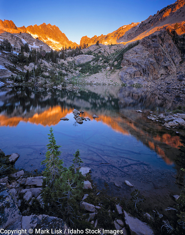 Upper Finger of Fate lakes reflect another day comming to an end. Sawtooth Wilderness Area, Idaho.