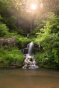 Landscape shot of a cascading waterfall