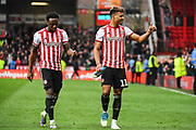 Brentford Forward Oliver Watkins (11) and Brentford Midfielder Moses Odubajo (2) thank the fans after the EFL Sky Bet Championship match between Brentford and Queens Park Rangers at Griffin Park, London, England on 2 March 2019.