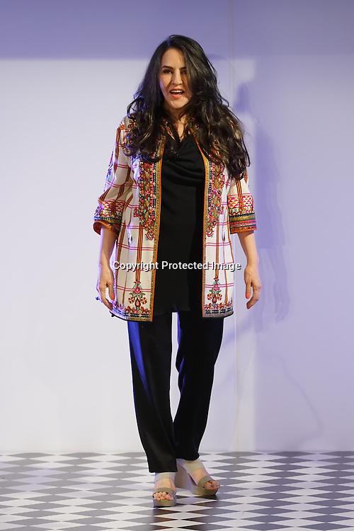 London,England,UK : 31th May 2016 : Pakistani Fashion Designer Faiza Samee latest designer catwalk at the Fashion Parade in supporting 'save the children' at Mandarin Oriental Hotel, London. Photo by See Li