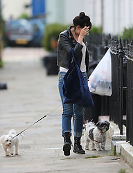(EXCLUSIVE PICTURES) First pictures of Daisy Lowe since the recent news she as split from Thomas Cohen after dating for five months. The model wearing a black leather jacket, white top, jeans and a pair of black boots arriving home with her two beloved dogs... London, UK. 26/05/2016 <br /> BYLINE MUST READ : JAMESY/GOTCHA IMAGES<br /> <br /> Copyright by © Gotcha Images Ltd. All rights reserved.<br /> Usage of this image is conditional upon the acceptance <br /> of Gotcha Images Ltd, terms and conditions available at<br /> www.gotchaimages.com