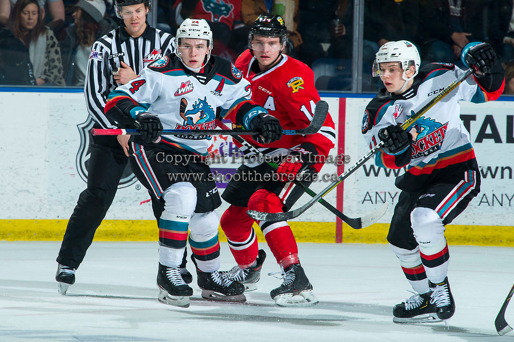 KELOWNA, BC - FEBRUARY 7: Jake Gricius #14 of the Portland Winterhawks is checked by Kyle Topping #24 after the face-off as Pavel Novak #11 of the Kelowna Rockets passes the puck at Prospera Place on February 7, 2020 in Kelowna, Canada. (Photo by Marissa Baecker/Shoot the Breeze)