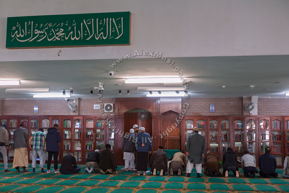 Members of the Islamic community are praying inside Birmingham Central Mosque.